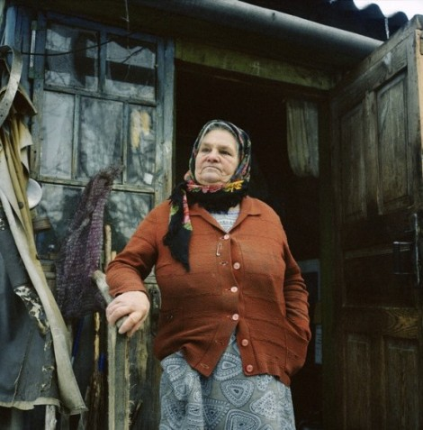 Maria Urupa (77 years) on the porch of her house in Parishev village. When the authorities came to evacuate the village after the accident, Maria decided to hide in the basement with her cows. 'We didn't care about radiation, it hunger that scared us the most' – she said. Chernobyl, Ukraine. December 2010.