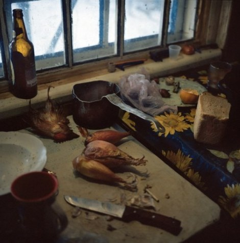 Galina Konyushok butchered a chicken to cook a broth. The food chain has been contaminated with radiation, especially animals that consume local food, such as grain and vegetation from the zone. Zirka village. Chernobyl, Ukraine. December 2010.